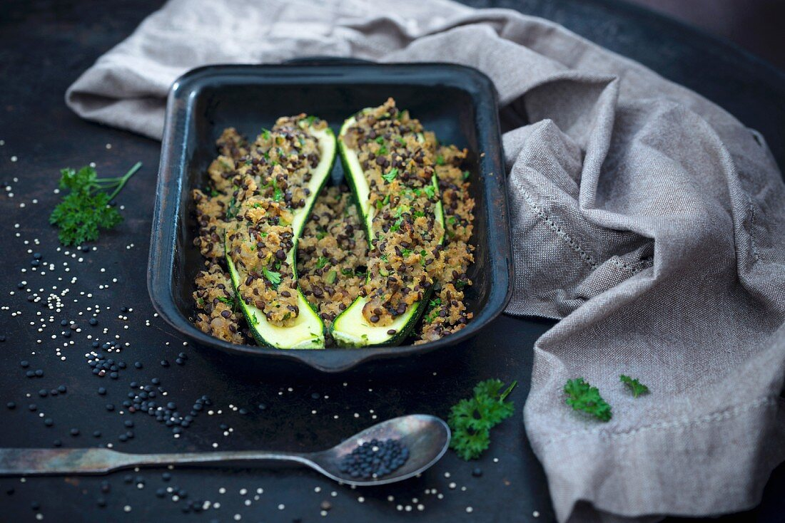 Vegan courgette filled with quinoa and beluga lentils