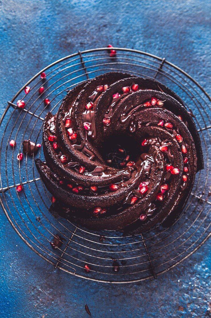 A chocolate Bundt swirl cake garnished with pomegranate seeds