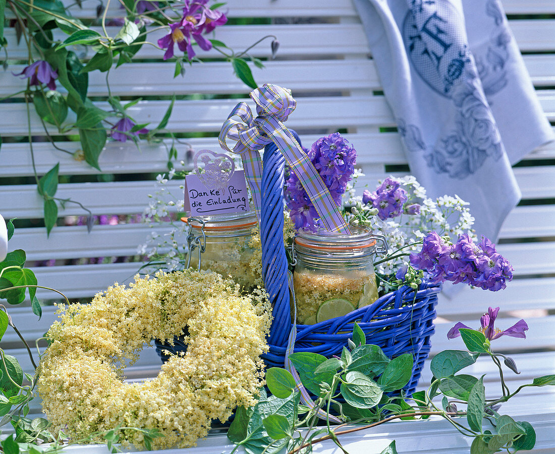 Basket as a gift with elderflower syrup, Delphinium (Larkspur,
