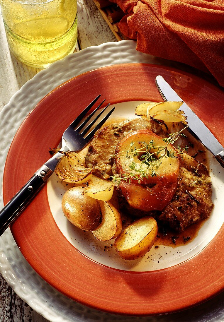 Pork cooked in apple cider with potatoes