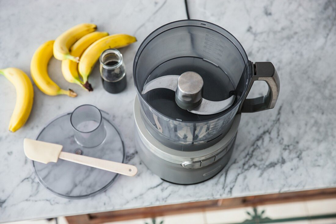 A food processor with S-shaped blade for chopping