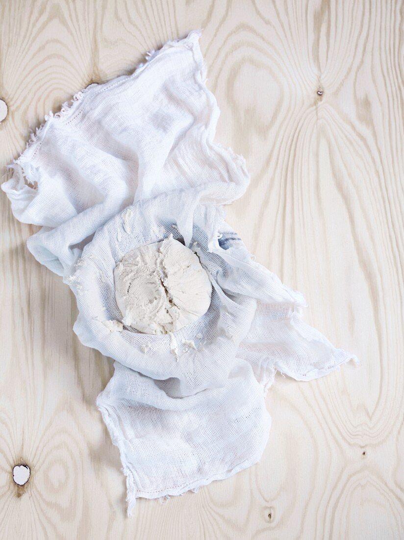 Homemade ricotta in a gauze cloth