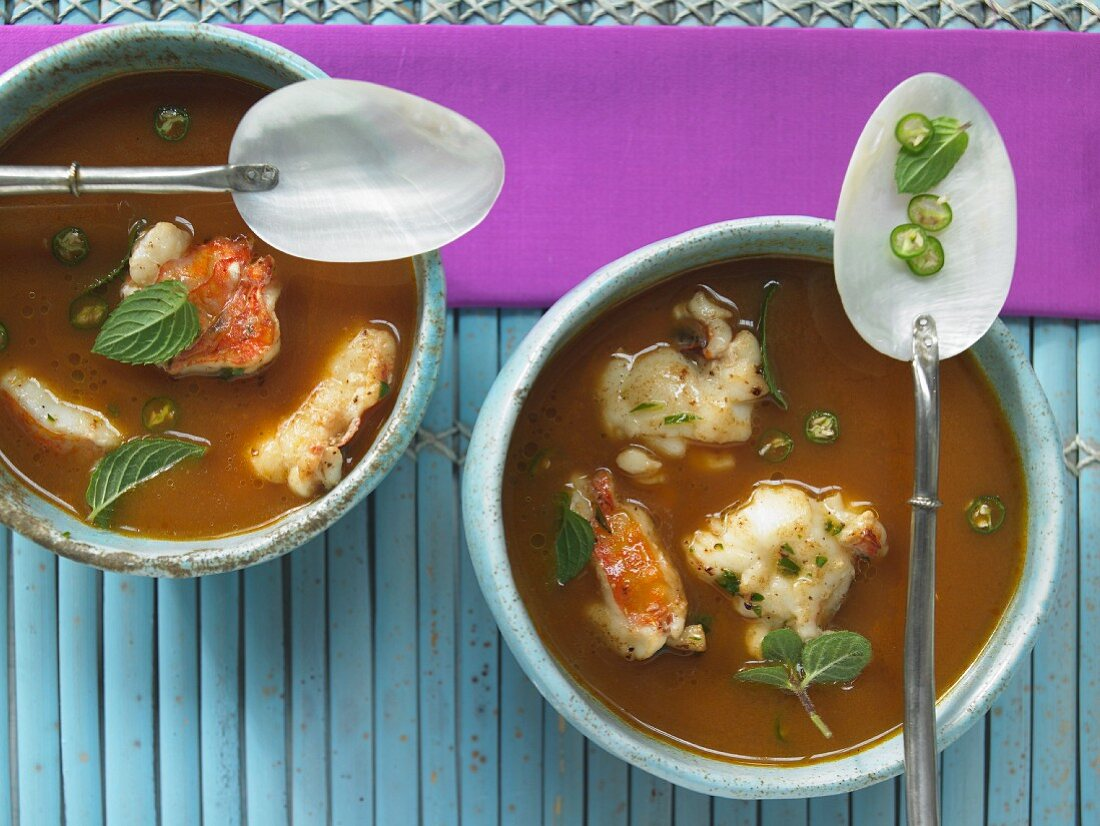 Crawfish soup with tomatoes, ginger and chili