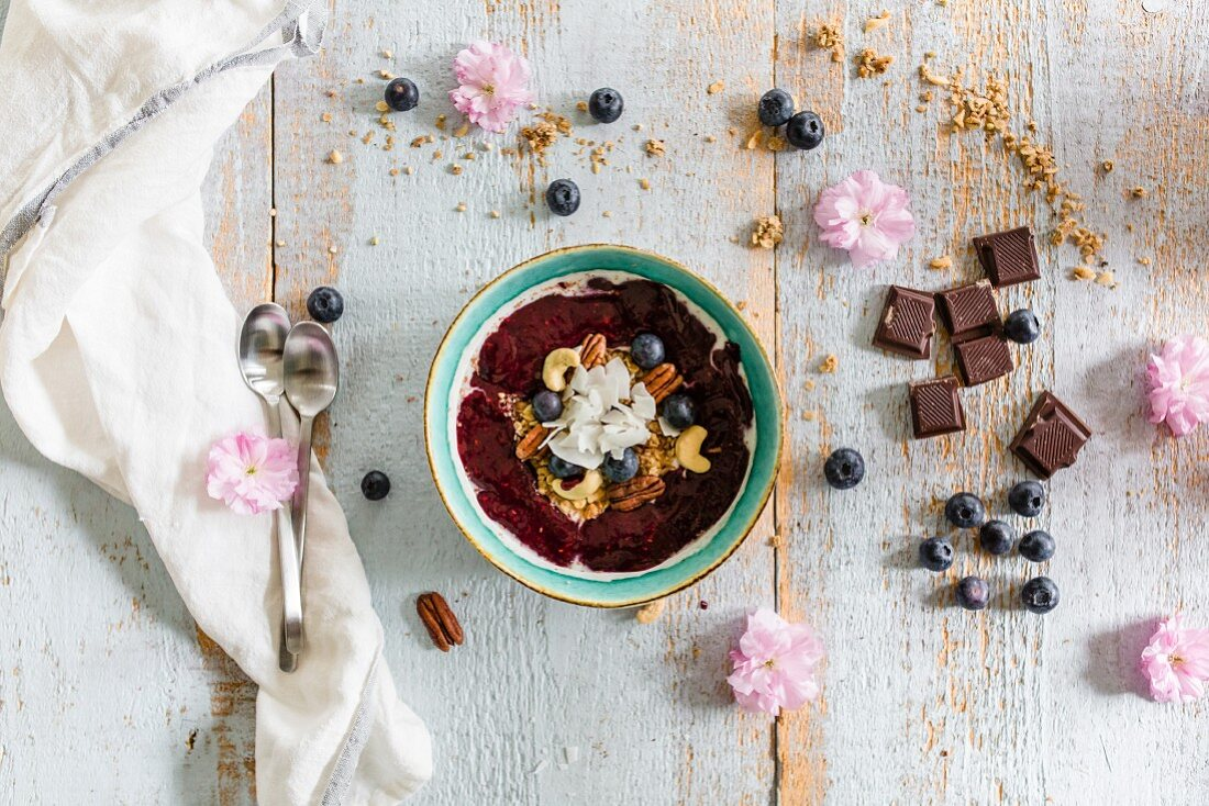 A smoothie bowl with berries and nuts