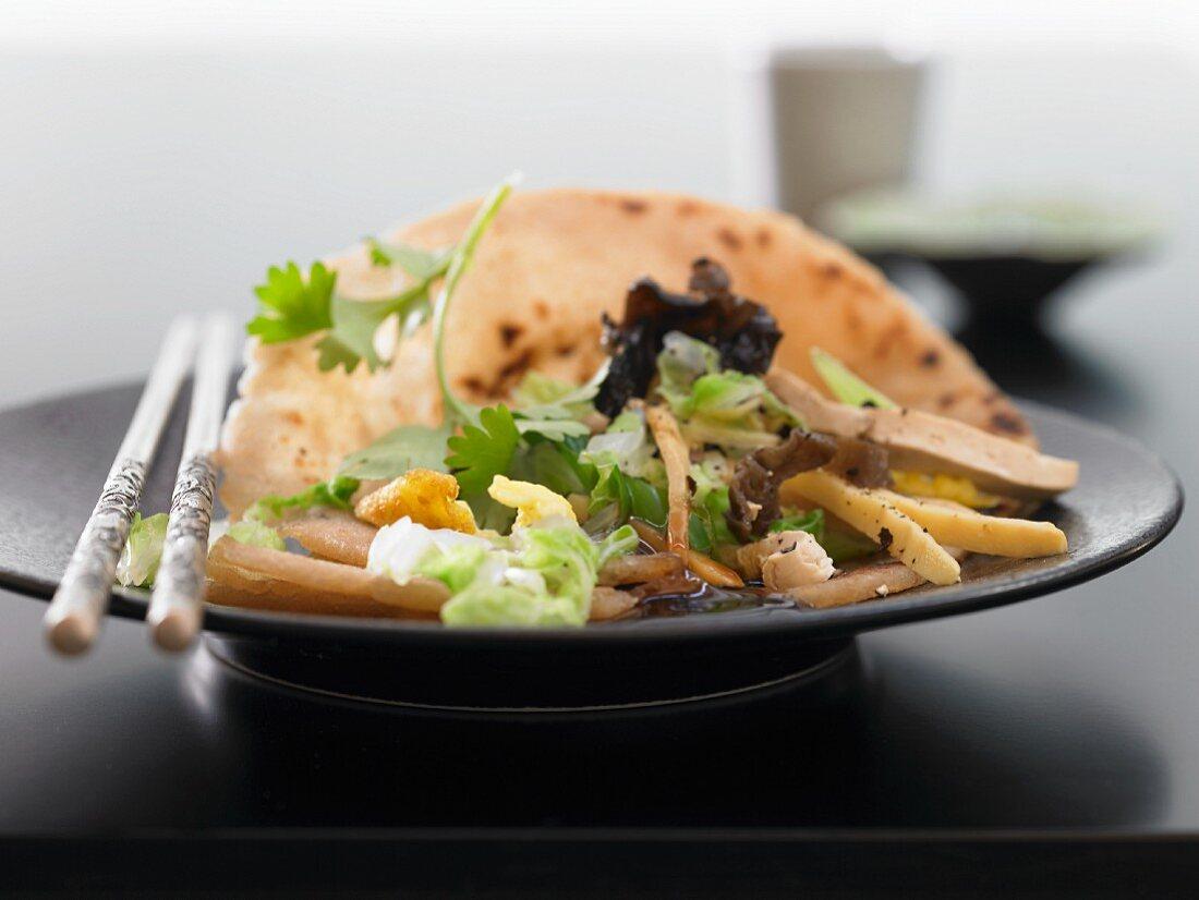 Mu shu tofu in pancakes with cabbage and mushrooms