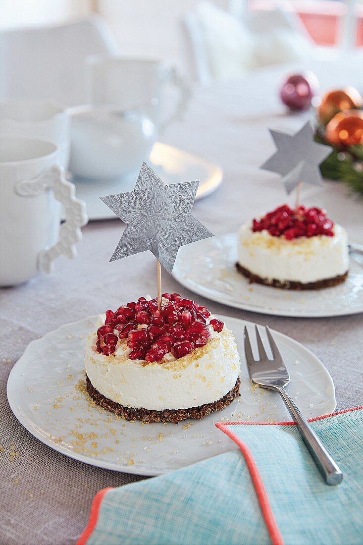 Small Advent cakes with pumpernickel and pomegranate seeds on a table