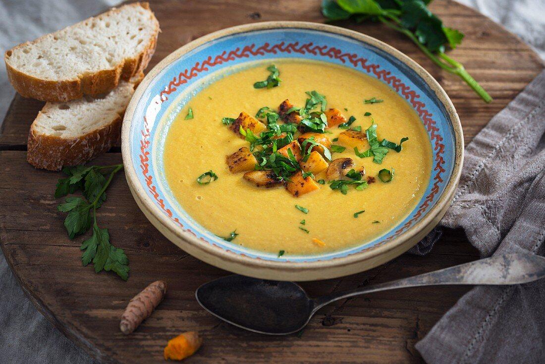 Vegan sweet potato and turnip soup with fresh turmeric