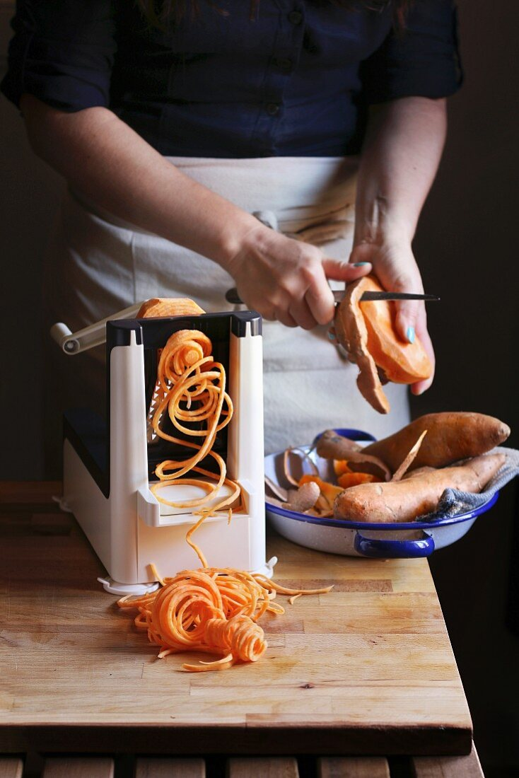 Making sweet potato noodle with a spiralizer machine