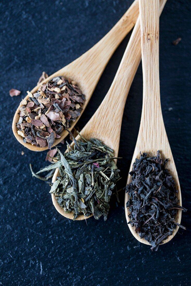 Various teas on bamboo spoons