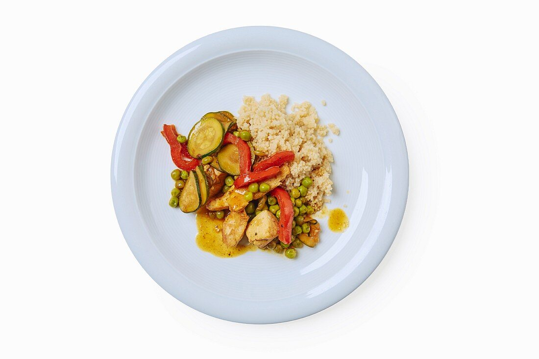 A chicken dish with the Moroccan spice mixture ras el hanout, vegetables and couscous
