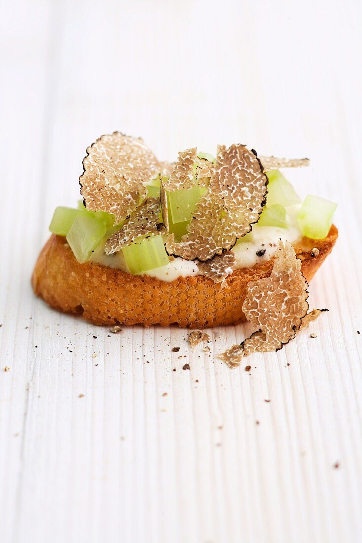 A crostini with truffle and celery