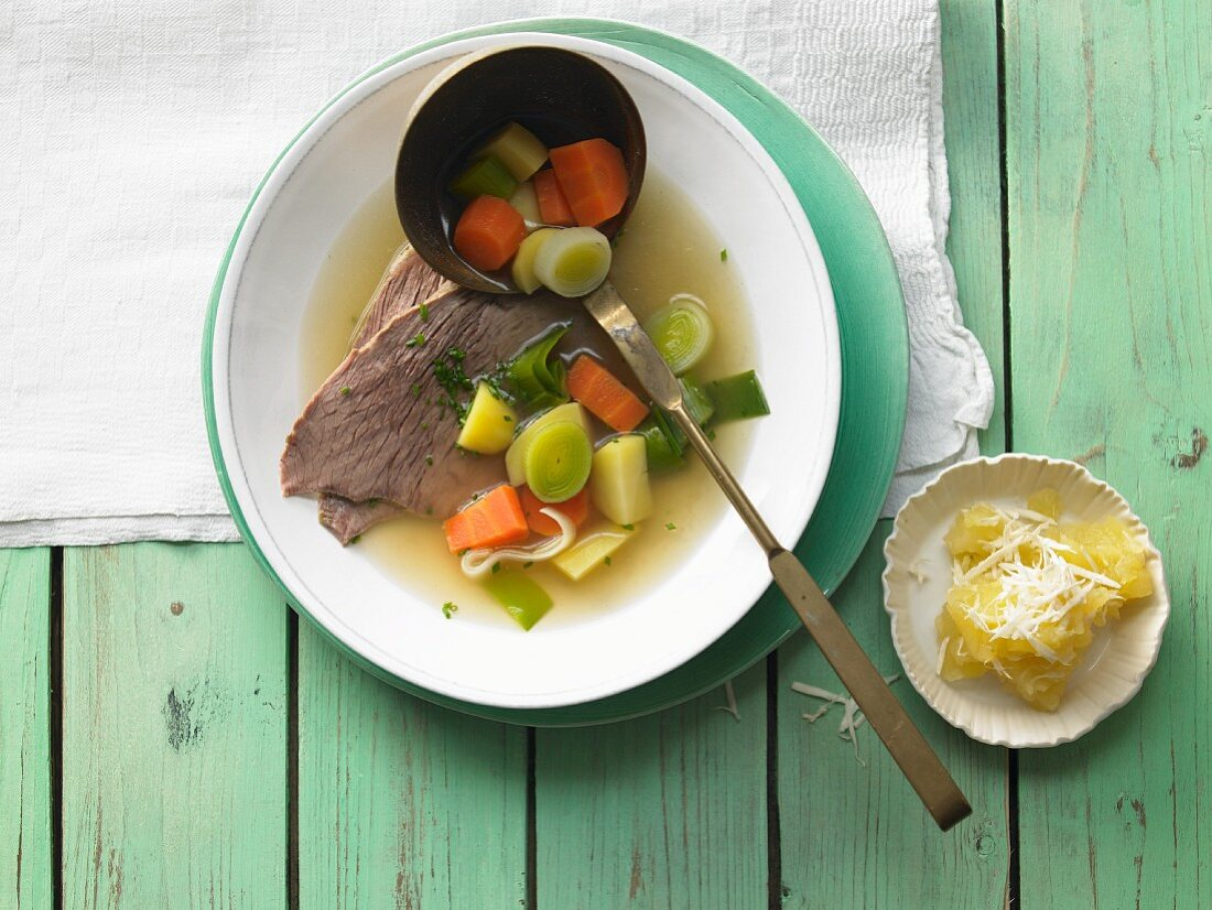Boiled veal with vegetables and apple and horseradish