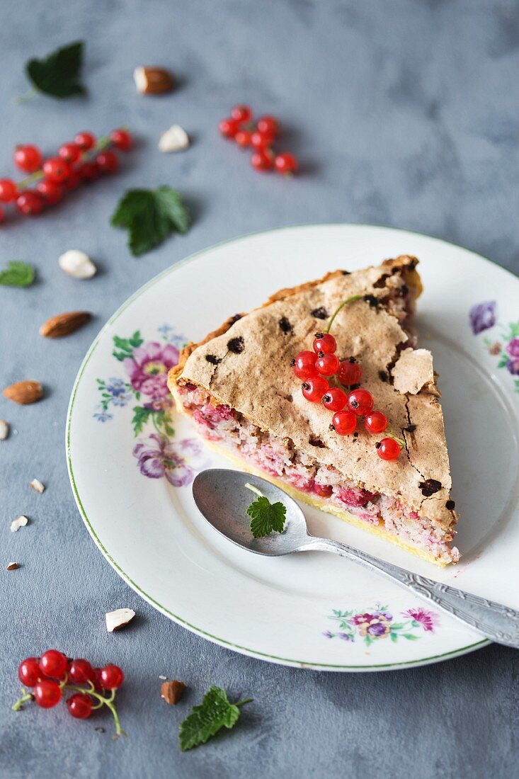 A slice of redcurrant and almond tart