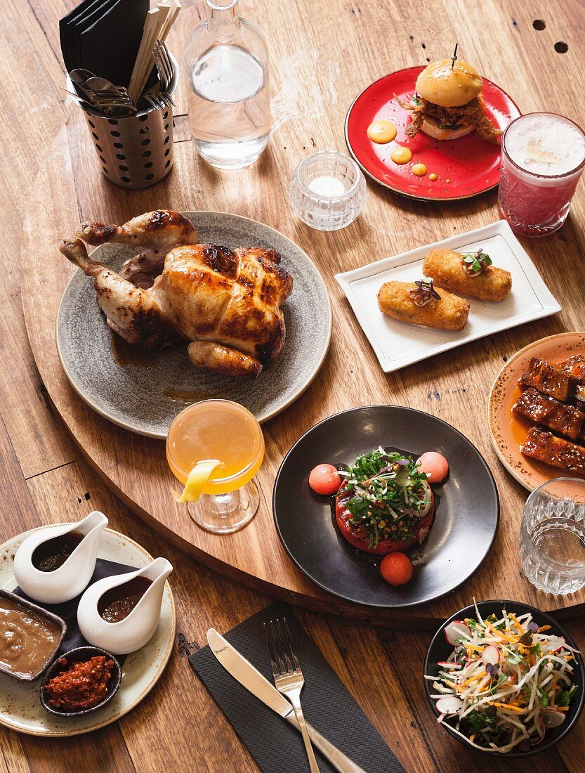 Chicken, croquettes, sliders, sticky pork, grilled watermelon, salad and cocktails (Australia)