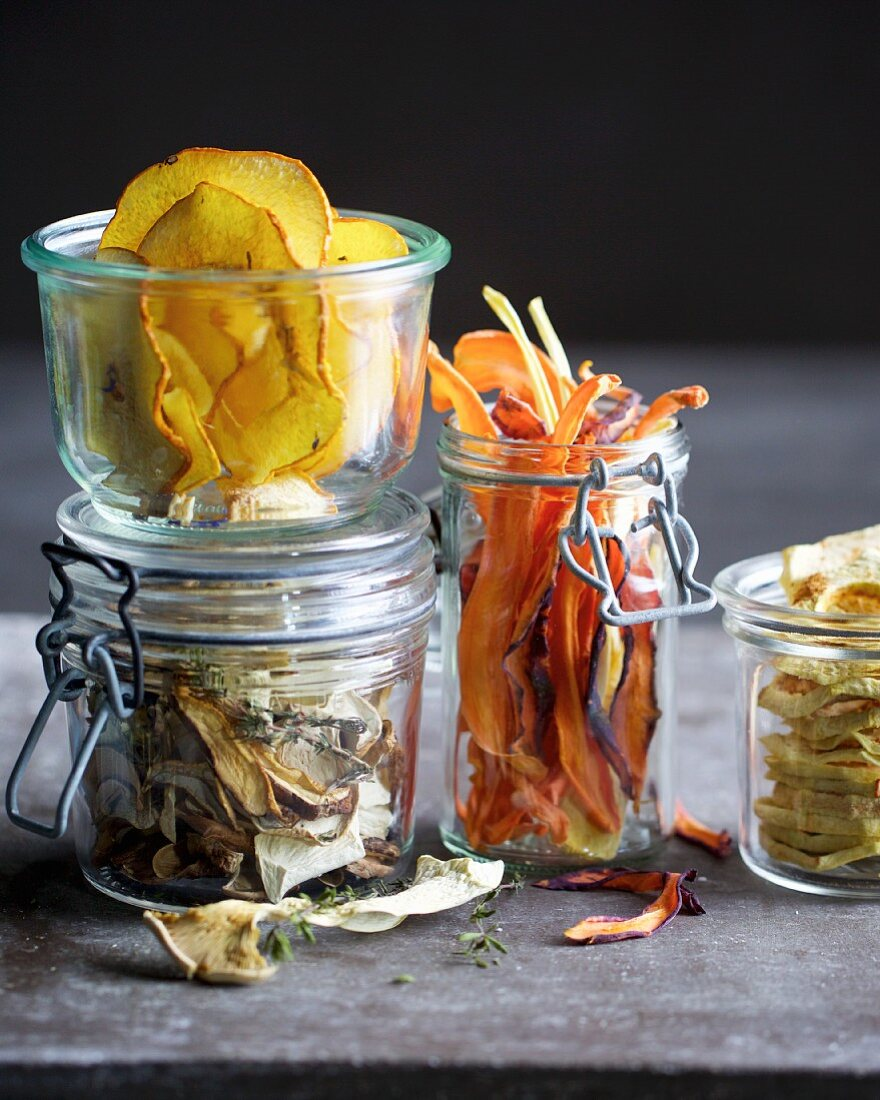 Dried fruit and vegetables in storage jars
