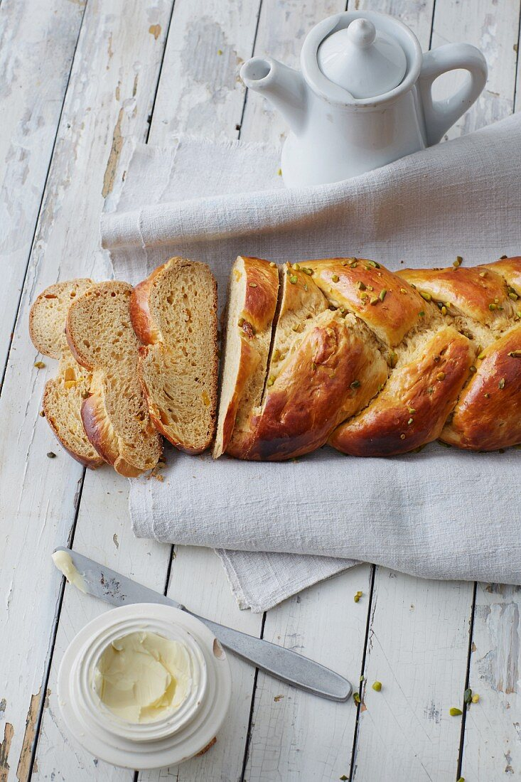 Sugar-free plaited sweet yeast bread with mango, pistachio and cardamom