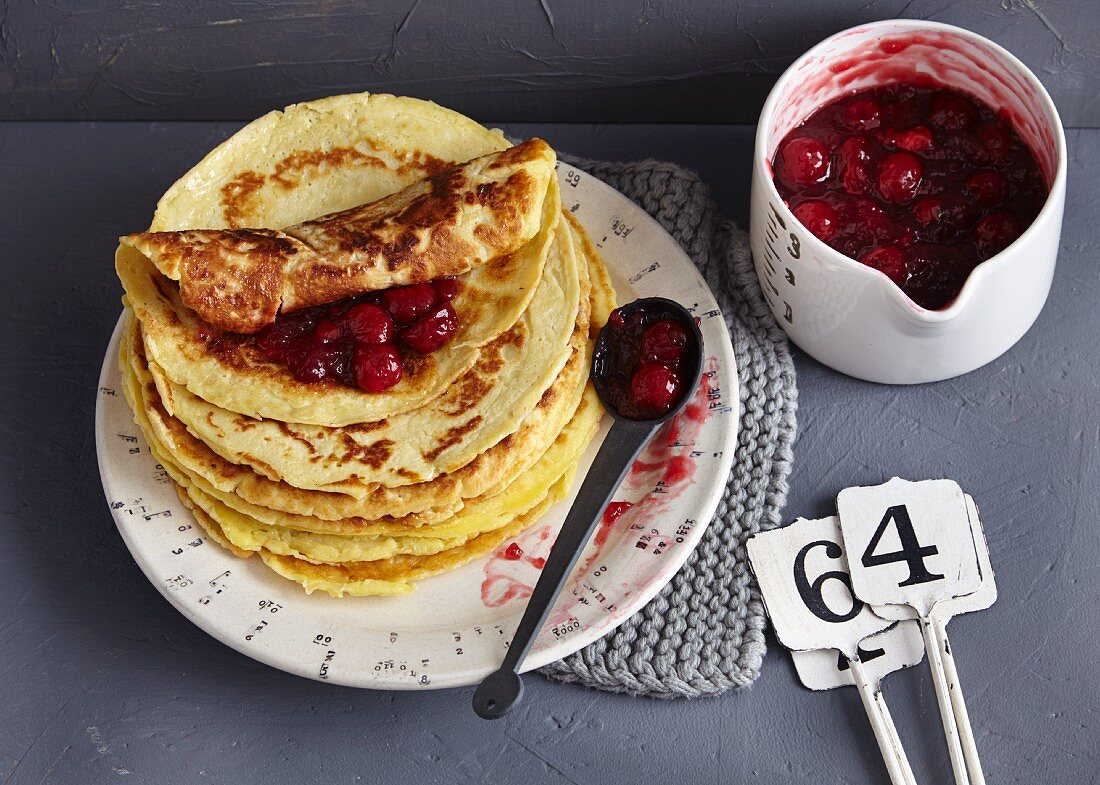 A stack of crêpes with sour cherry ragout