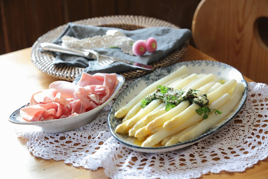 White asparagus, pink pepper and chervil butter, and ham