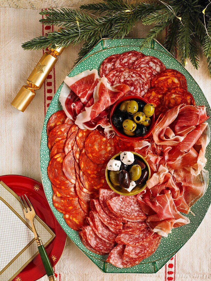 Continental Christmas meat platter with salami, raw ham, olives and feta