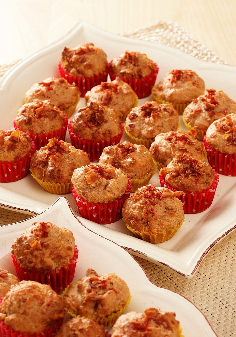 Bite sized cheese and bacon muffins on cream plates
