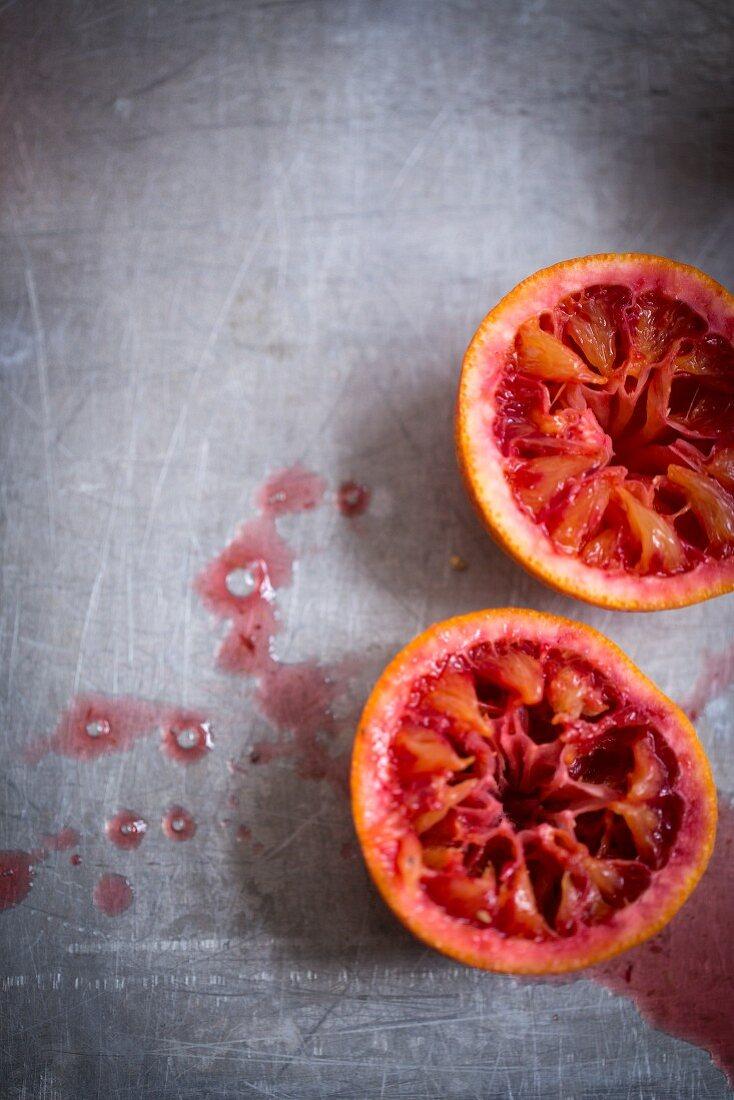 Pressed blood orange halves (seen from above)