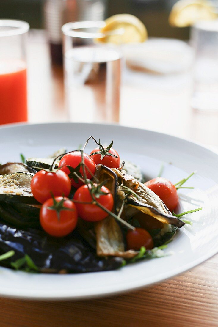A salad with aubergines and tomatoes in a restaurant