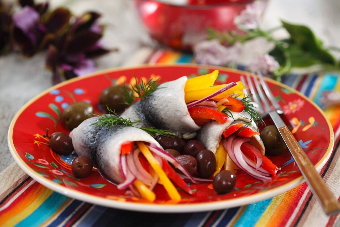 Marinated herring with peppers and olives