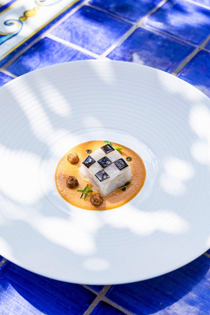 A dish from Quattro Passi: Scampi with a Parmesan and aubergine sauce and buffalo mozzarella, Amalfi coast, Italy