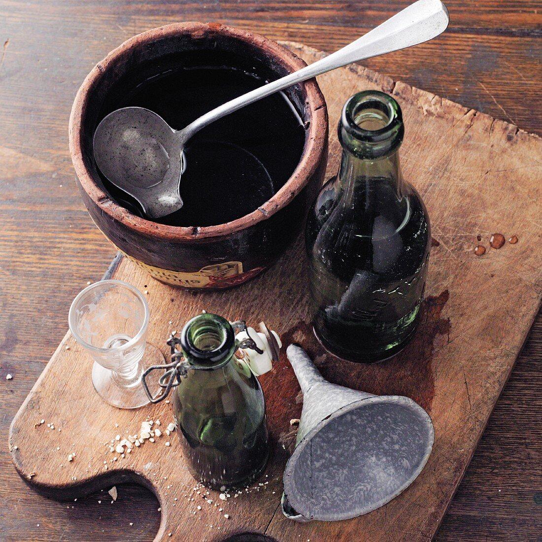Wild arum elixir (à la Hildegard von Bingen) being poured into bottles