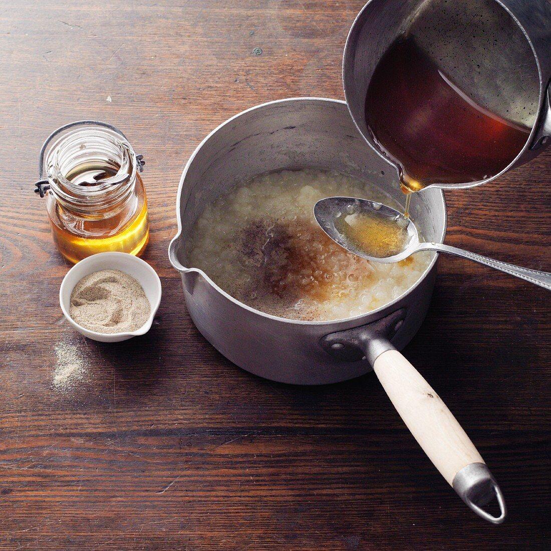 Baldmoney pear honey à la Hildegard von Bingen being made: honey being added to stewed pears