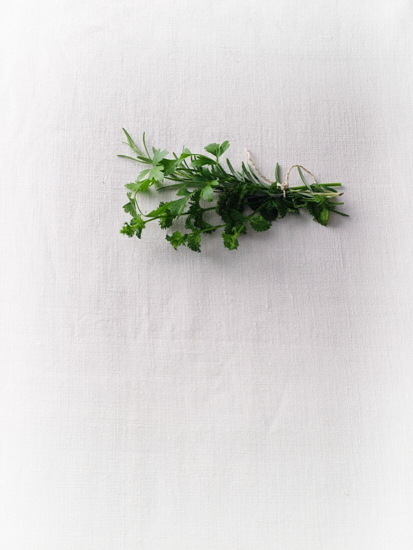 A bunch of herbs with parsley, rosemary, herb mint