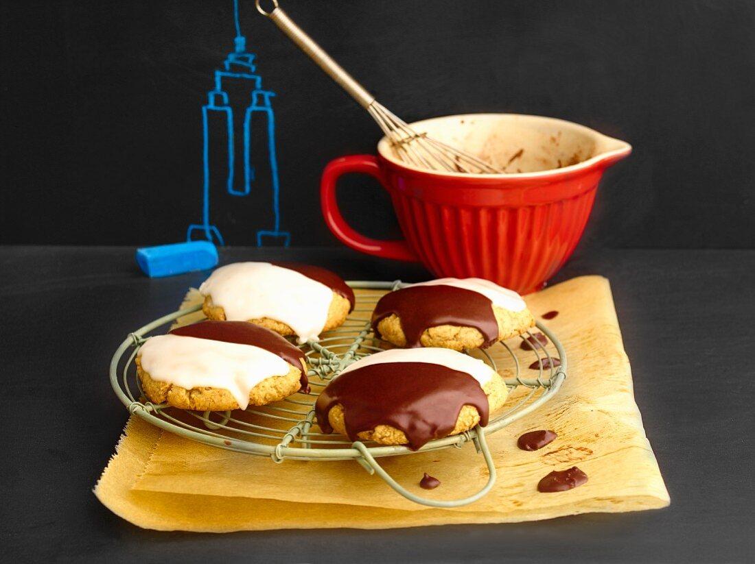 Amerikaner (soft, sponge cake-like shortbread) with white and dark chocolate glaze