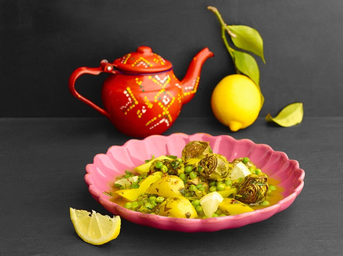 Vegetable tagine with potatoes, peas and artichokes
