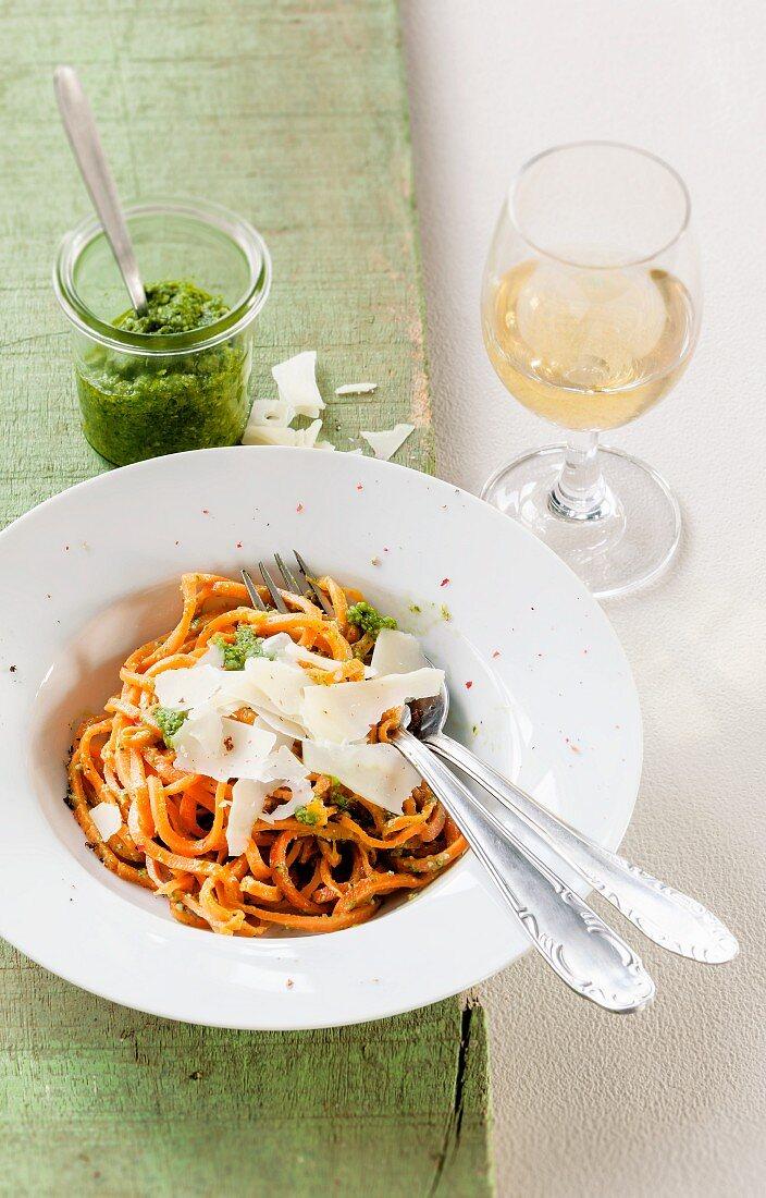 Carrot spaghetti with wild garlic pesto and Parmesan cheese