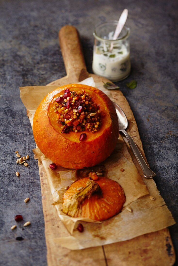 Stuffed pumpkin with buckwheat and pomegranate seeds