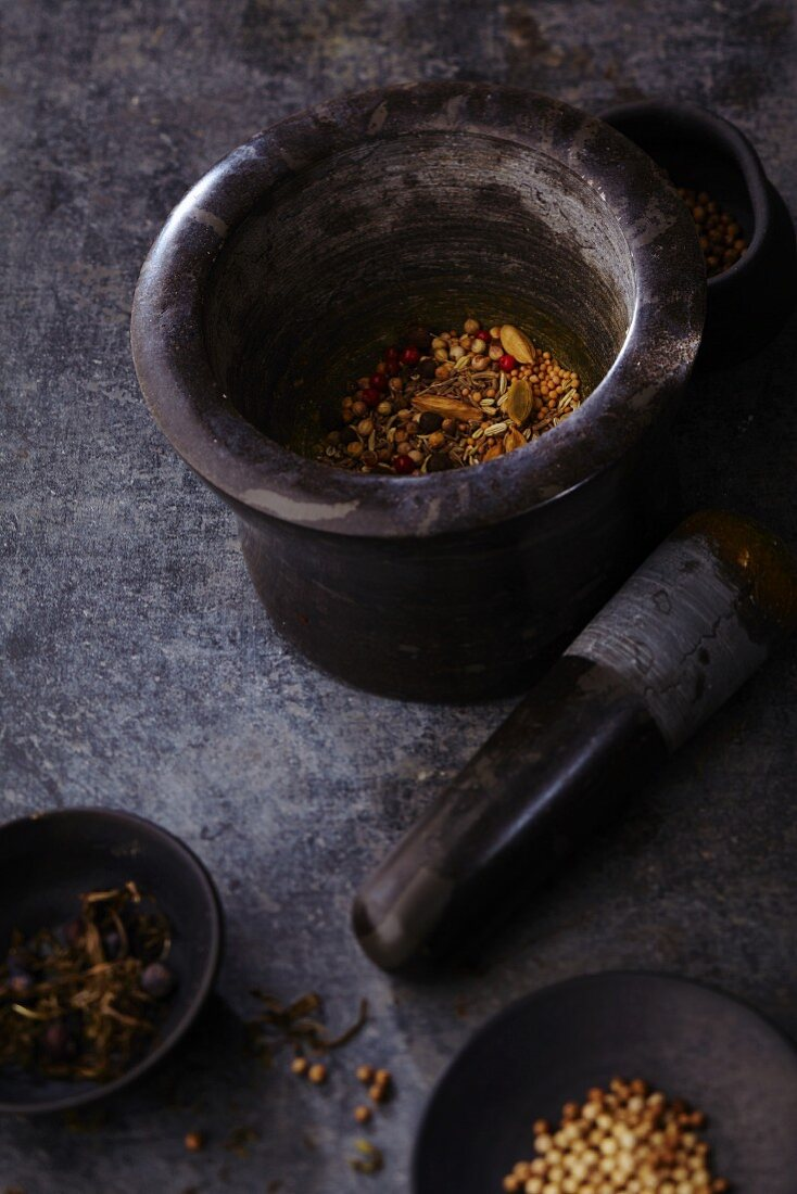 Assorted spices in a mortar