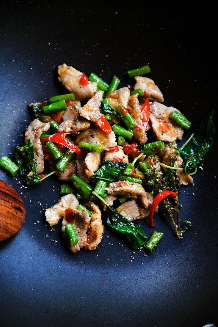 Pad Grapau Gai Sai Tua Fak Yao (chicken with beans, chilli and basil, Thailand)