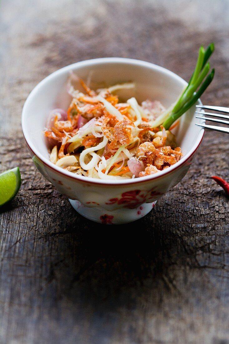 Yam Mamuang Sai Gung (salad with green mango, prawns and coconut, Thailand)