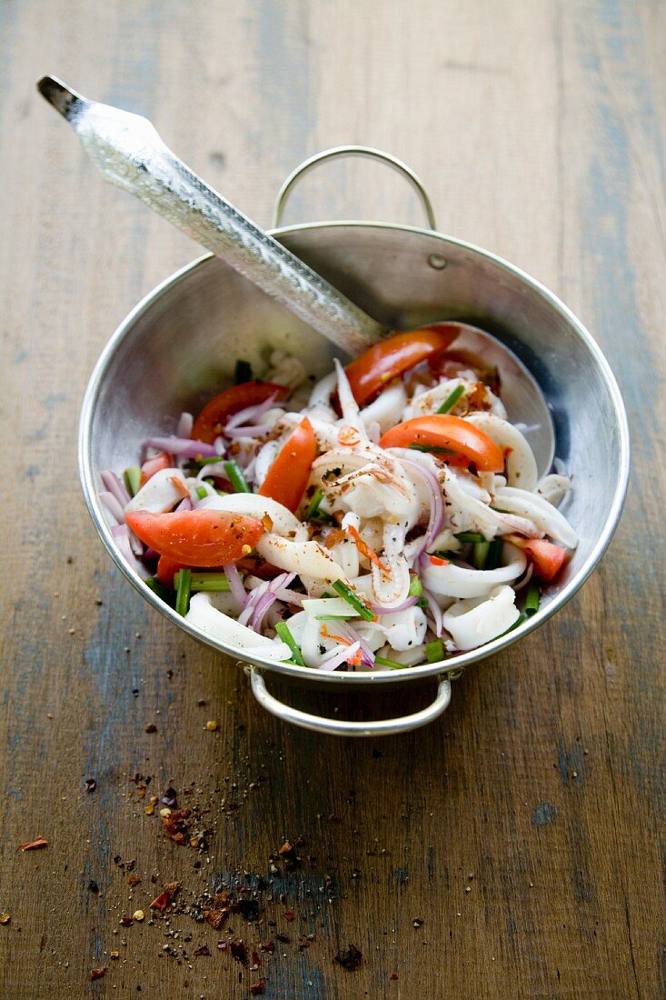 Yam Pla Mük (spicy squid salad with tomatoes, Thailand)