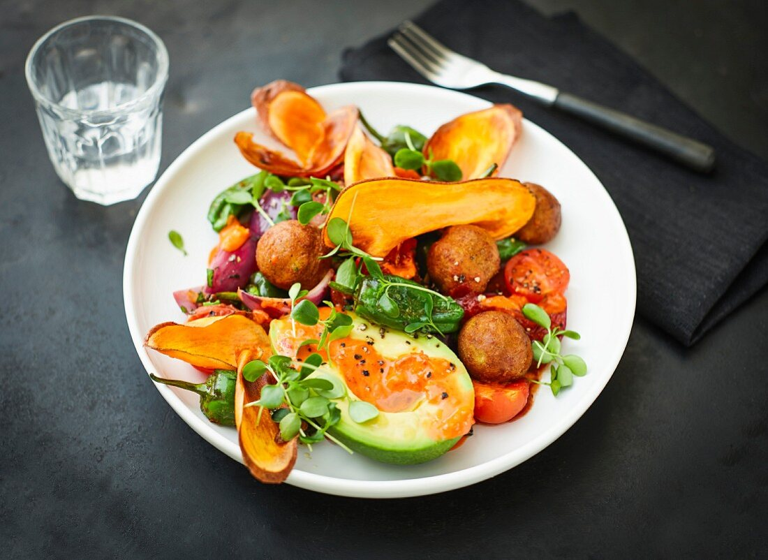 Chickpea balls with fried sweet potato slices, avocado, cherry tomatoes and ajvar (Vegan)