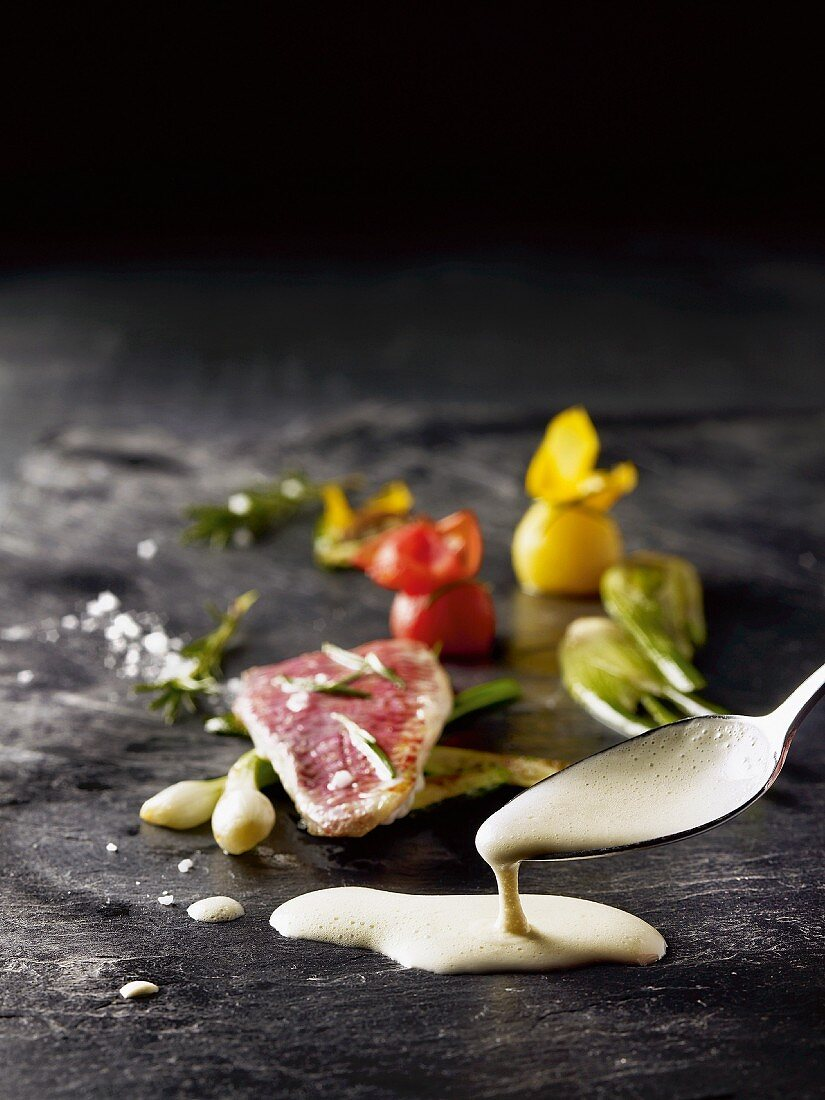 Pigeon breast with a light sauce and vegetables