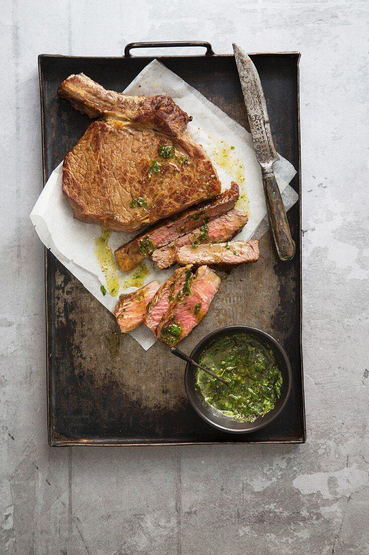Ribeye steak with herb sauce
