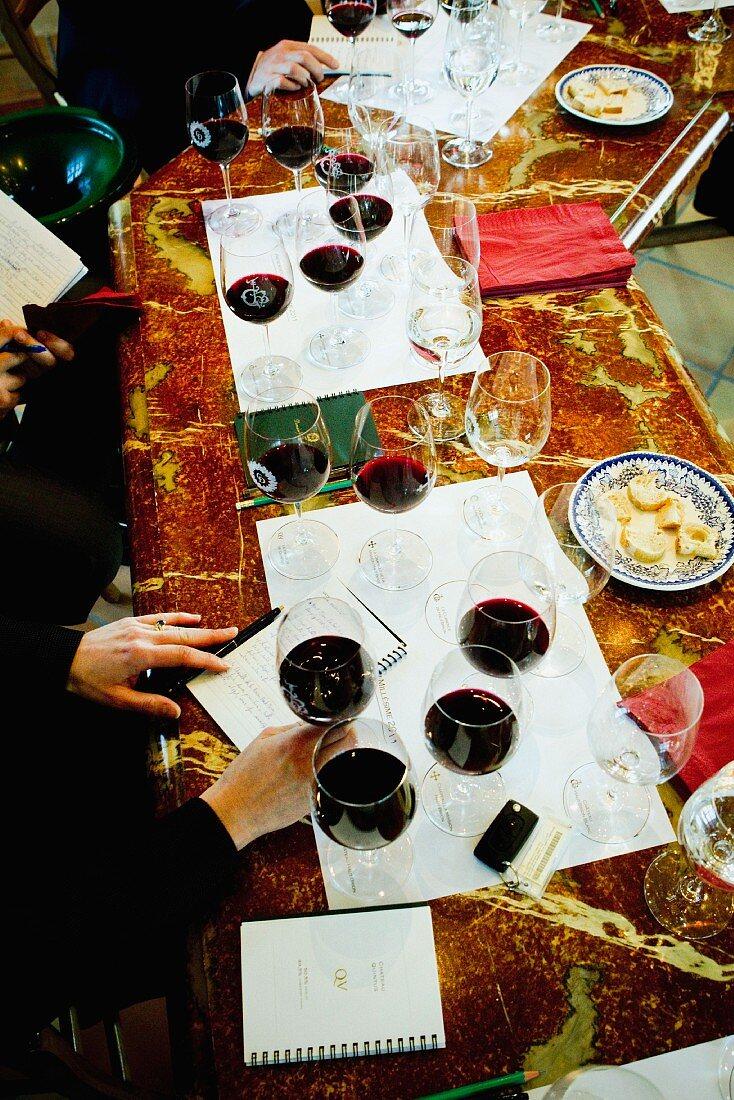 People tasting wine