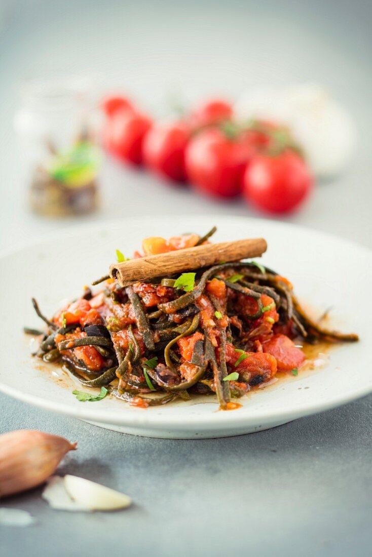 Seaweed pasta alla puttanesca with cinnamon