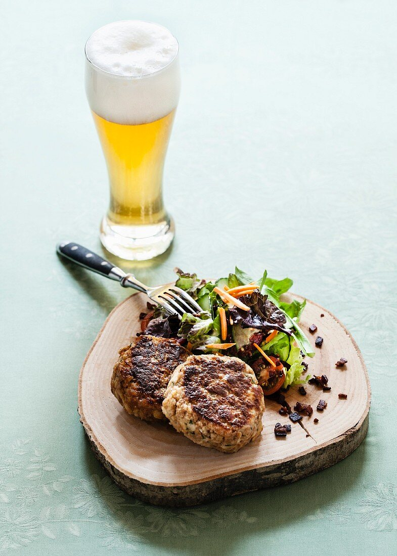 Kaspressknödel (bread and cheese dumplings) with amixed salad and a beer