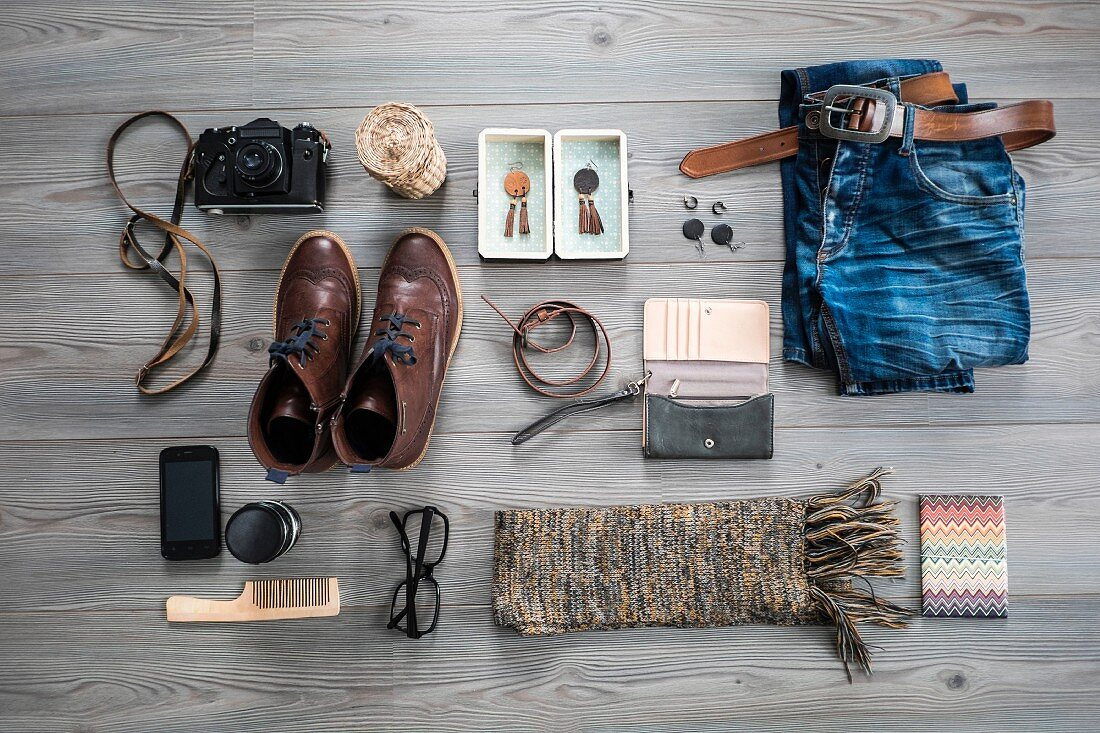 Clothing and accessories on a grey wooden table