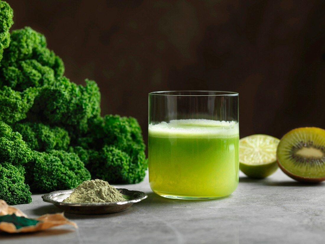 Green smoothie made with kale, kiwi, spirulina and stinging nettle powder