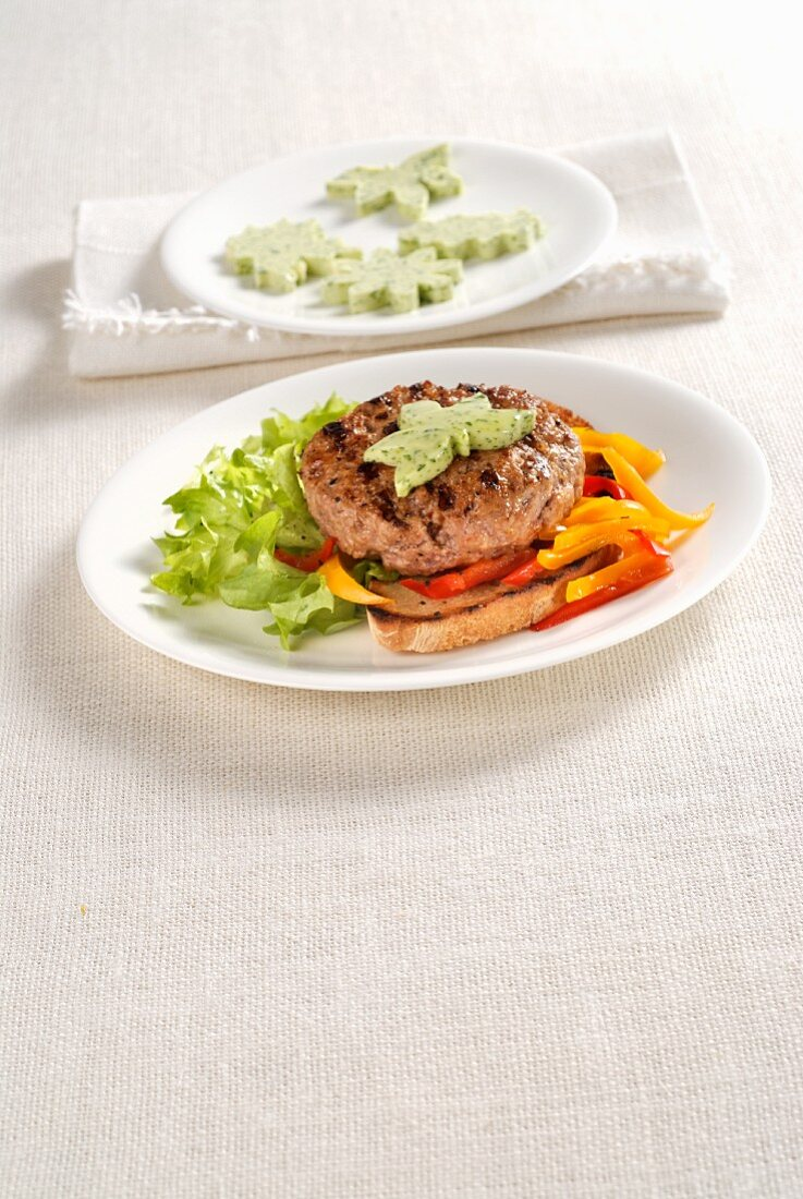 A veal burger on toast with herb butter