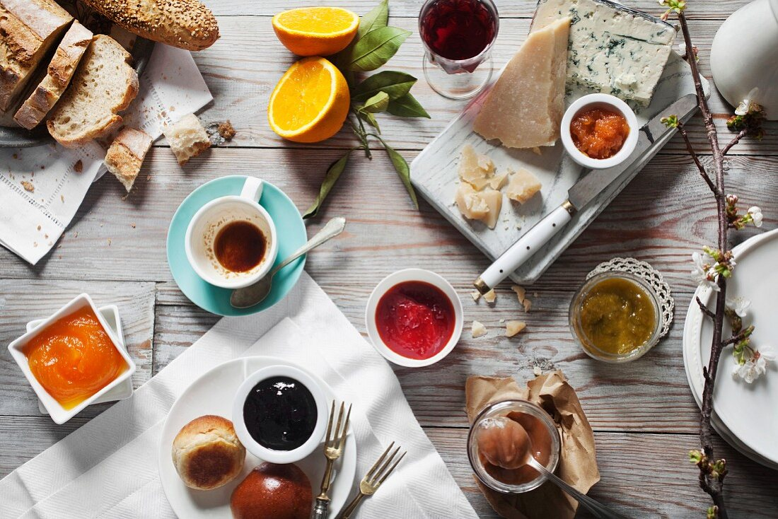 Various types of jam and jellies with cheese and bread