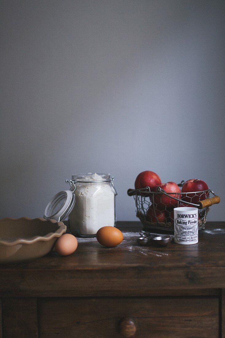 Ingredients for nectarine pie on a wooden chest of drawers